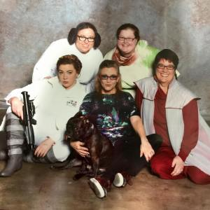 Princess Leia Photo Op from SLCC FanX. Our family dressed up as different versions of Leia!