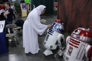 Me as Leia with R2-D2 recreating a scene from A New Hope