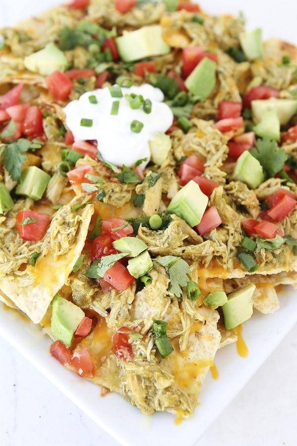 Chicken Chile Verde Nachos Recipe on twopeasandtheirpod.com Perfect for game day!