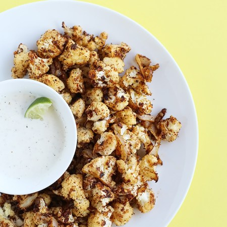 Spicy Roasted Cauliflower paired with a lime dipping sauce is perfect for an appetizer or side dish, and quick and easy to make. Vegan and Gluten Free. / TwoRaspberries.com