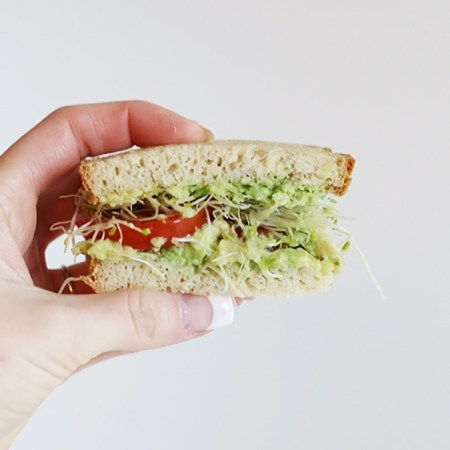 My Favorite Easy Avocado Tomato Sandwich! Avocado and tomato make such a wonderful combo the sprouts add many vitamins, minerals and enzymes! Vegan and GF / TwoRaspberries.com