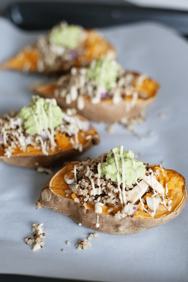 These Healthy Quinoa Stuffed Sweet Potatoes are oil free, vegan and gluten free topped with avocado and a sweet tahini sauce. | TwoRaspberries.com