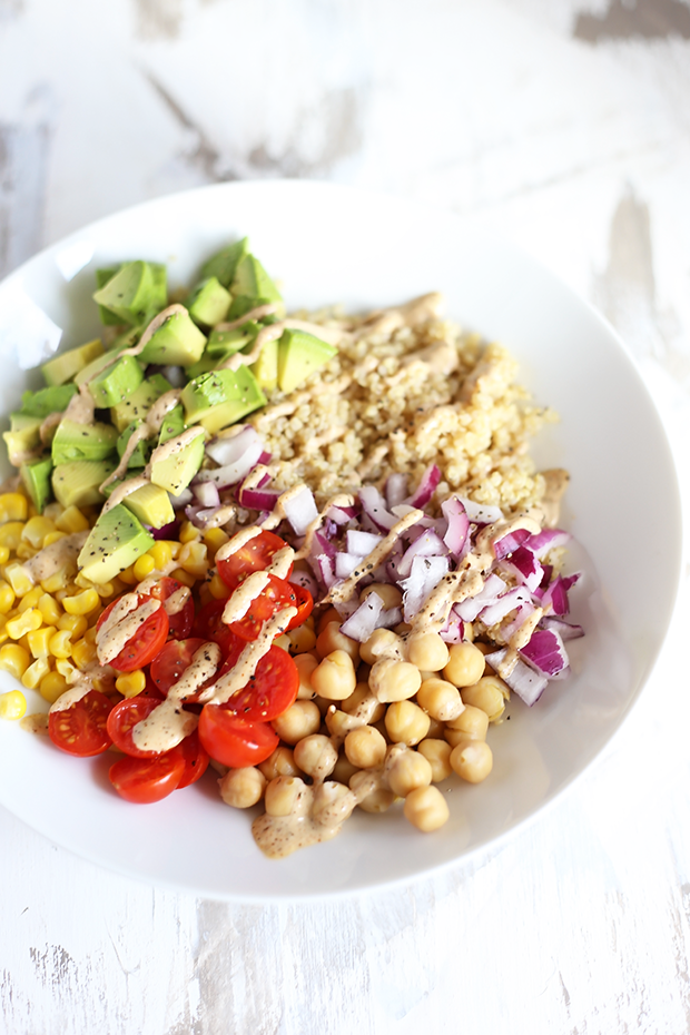 Healthy Quinoa Burrito Bowl with Spicy Tahini Sauce! quick + easy to make. Perfect for meal prepping, packed with protein, Vegan, GF and Oil Free. | TwoRaspberries.com