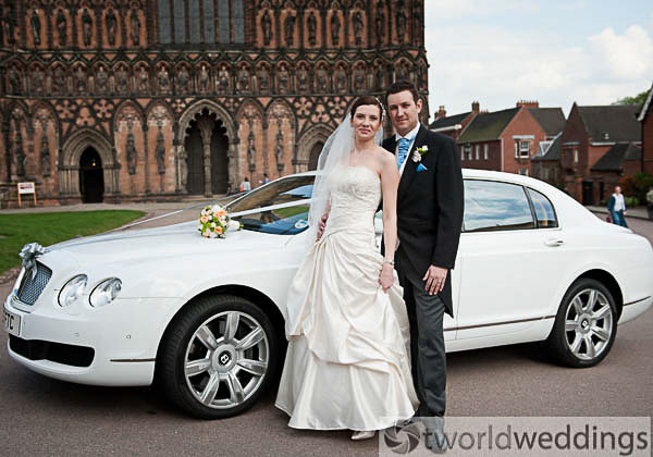 Bride and groom outside Lichfield Cathedral on their wedding day. Photo by TWorld Weddings