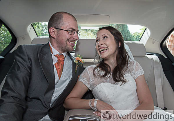 Wedding couple in car after their wedding services. Wedding photography by TWorld Weddings