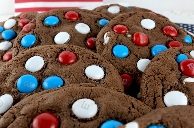 Red White and Blue Chocolate Cookies - a fun and patriotic dessert to bring to a 4th of July party. These colorful Fourth of July Cookies are delicious and easy to make. Pin this delicious 4th of July treat for later and follow us for more great 4th of July Food Ideas. #4thofJuly #fourthofjuly #4thofJulyTreats #MandMs #RedWhiteandBlue #TwoSistersCrafting