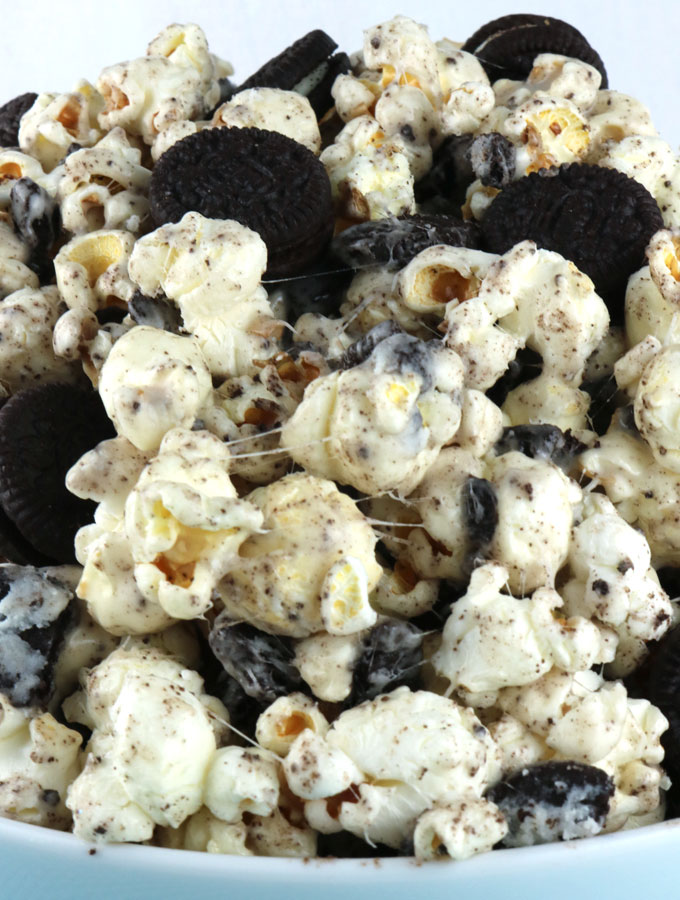 Oreo Cookie Popcorn Recipe | Two Sisters Crafting - sweet and salty popcorn covered in marshmallow and mixed with yummy Oreos. A yummy Oreo dessert that is super easy to make! Pin this delicious popcorn treat for later and follow us for more great Popcorn Recipes.