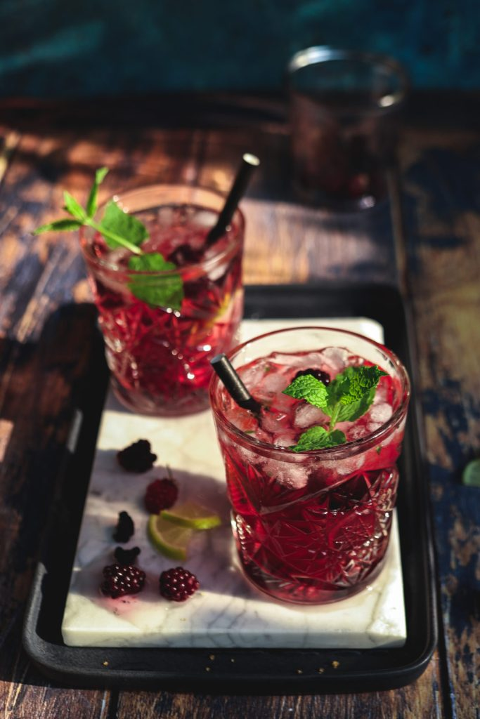 Blackberry-lavender Mojitos on a marbled surface