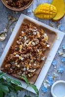 Hawaiian inspired tropical Granola with puffed spelt, puffed quinoa, rolled oats, macadamia nuts, coconut and dried pineapple and papaya.