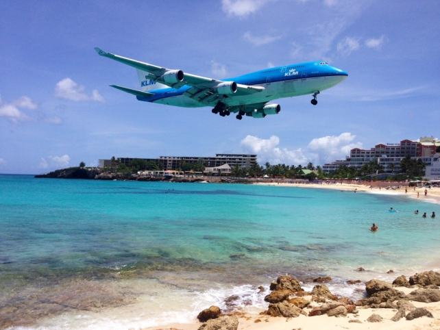 "Plane spotting in Maho Beach in St. Martin - ""Our 2016 Travel Wish List"" - Two Traveling Texans"