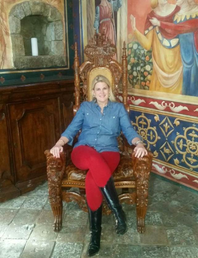 Katherine sitting in an ornate chair in the castle in Napa
