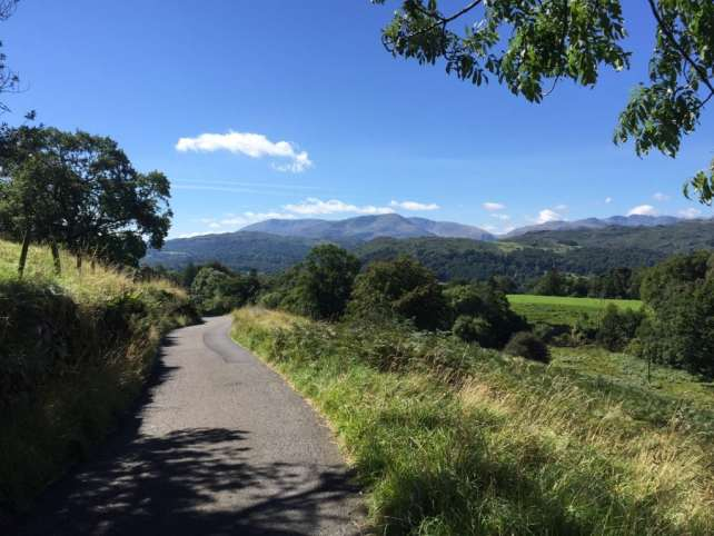 """A section of the hike where we were walking on the road, still so scenic! - """"An Introduction to England's Lake District"""" - Two Traveling Texans"""