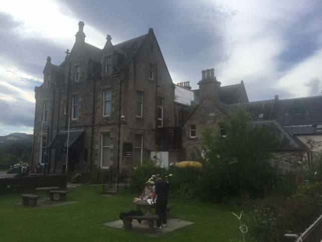 """Loch Ness Exhibition Centre is in a really pretty building! - """"Loch Ness: Searching for Nessie"""" - Two Traveling Texans"""