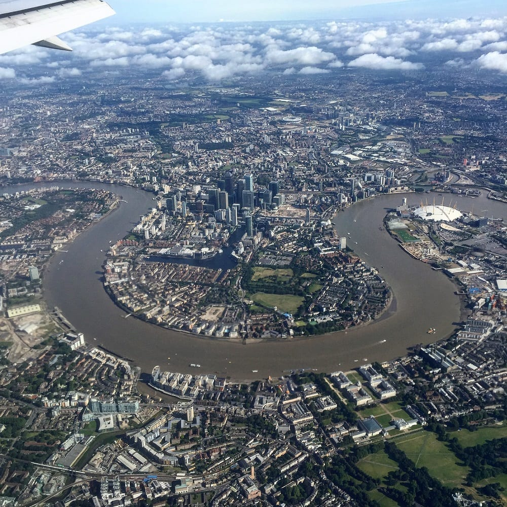 "Enjoying a nice view of London from my window seat (which I did not pay extra for!) - ""Travel Fees We Hate and How to Avoid Them"" - Two Traveling Texans"