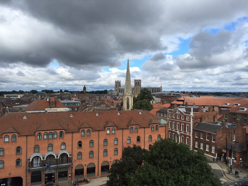 "The view from Clifford's Tower is spectacular. You can see York Minster in the distance. - ""York: Five Must See Historic Sites"" - Two Traveling Texans"