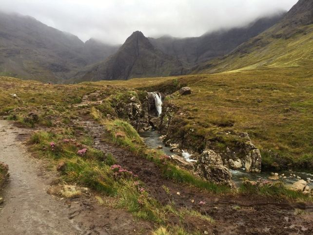 """The weather may have been disappointing but the Fairy Pools were still beautiful. - """"The Magical Fairy Pools in Isle of Skye, Scotland"""" - Two Traveling Texans"""