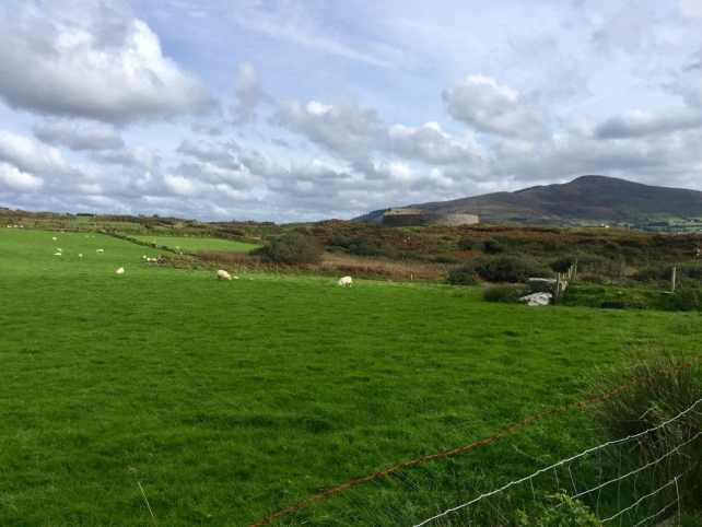 "Can you spot the stone fort? It really blends into the scenery. - ""Why You Must Do the Ring of Kerry at Least Once in Your Lifetime"" - Two Traveling Texans"