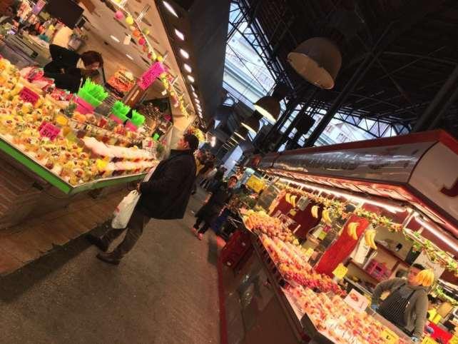 """One of the aisles in La Boqueria Market. - """"La Boqueria Market: Come Hungry!"""" - Two Traveling Texans"""