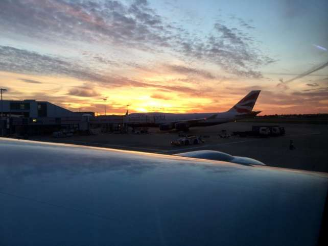 "Sunset at Heathrow Airport in London before the long flight back to New York City. - ""Neck Support Pillow and Other Travel Sleeping Tips"" - Two Traveling Texans"