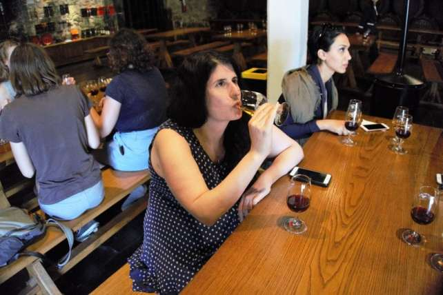 """Anisa tasting a white port for the first time. - """"Port House Visits and Cable Cars"""" - Two Traveling Texans"""