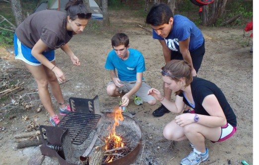 Students gather around a campfire during one of Fit & Rec's Outdoor Adventure trips. (Photo courtesty of TWU Fit & Rec)