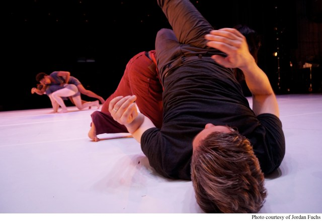 Three TWU Students and Fuchs practicing weight sharing and balance during an improvisational dance piece.