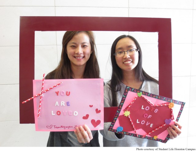 Houston students pose with Valentine's Day cards they made for patients at Texas Children's Hospital. According to Deborah Unruh Assistant Director of Student Life Houston Campus, students get together to create the cards and deliver them to the hospital.