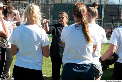 Before a practice, Coach Stidham talks with the softball team.