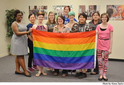 Members of TWU PRIDE pose together at their weekly Monday meeting.