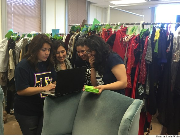 Junior and Senior Fashion Design and Fashion Merchandising majors Adriana Gonzalez,  Alyssa Arguello, Janet Najera and Andrea Rodriguez line up pieces for the show.