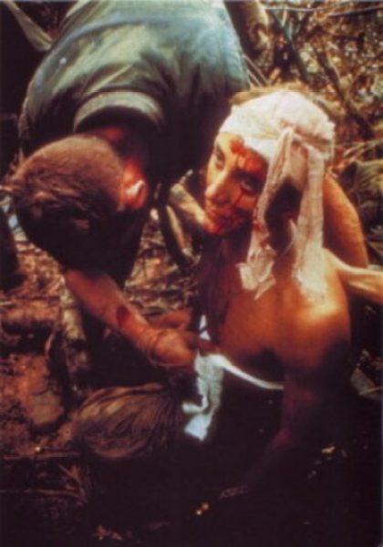 Navy Corpsman treats a Marine (Vietnam)