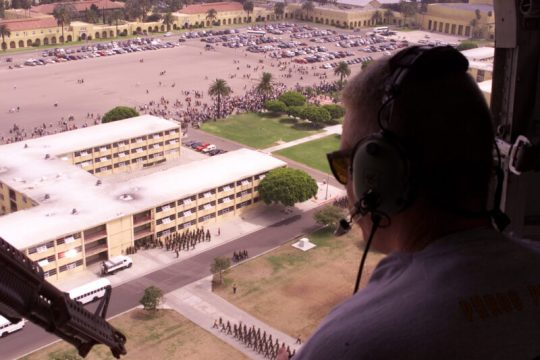 Cpl. Beddoe flying over MCRD San Diego in a restored USMC Sikorsky UH-34D Helicopter