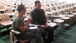Macias speaks with a student after the discussion.  Photo by: Caitlin Rodriguez