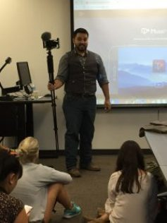 Gary Cooper teaches students about beastgrip- a phone holder and microphone that he enjoys using while out in the field getting film.