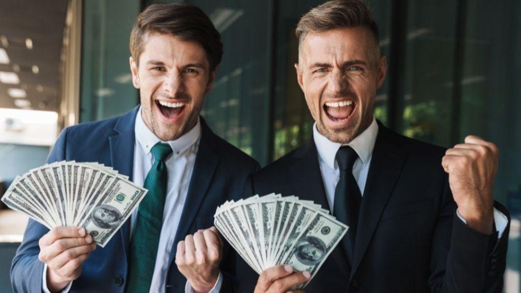men holding money