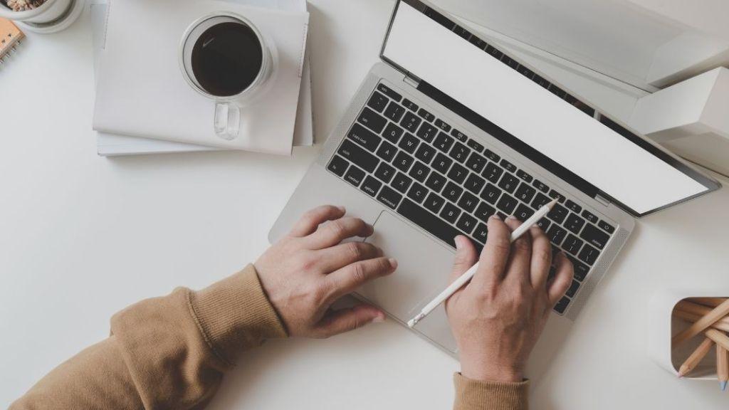 employee (hands working on laptop)