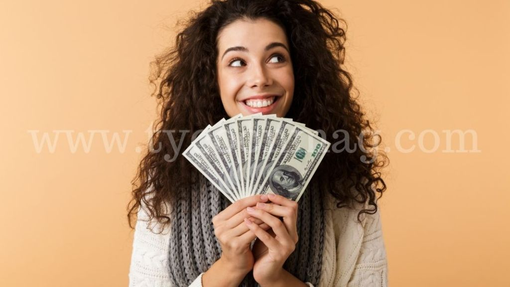 woman smiling holding money