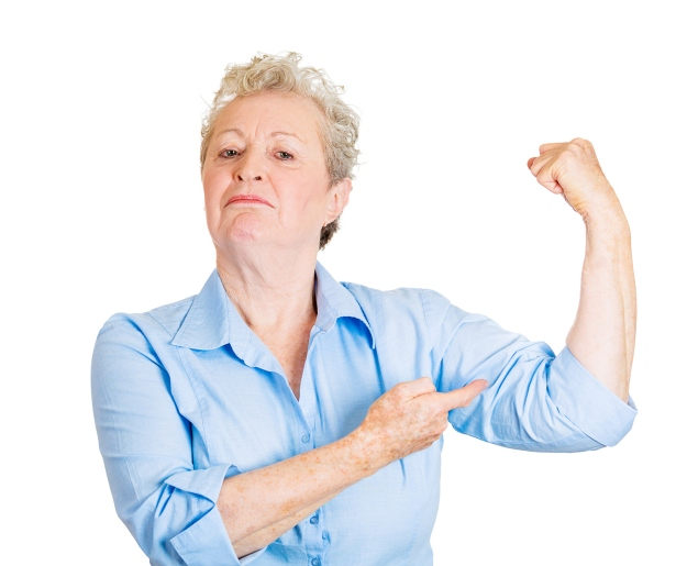 Woman showing her strength   Calcium Benefits: Alkaline Water is a Great Resource!   Strong woman. Senior elderly lady showing her strength
