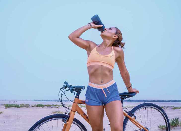 woman drinking water with her bicycle | Reasons to Love Tyent Water Ionizers, Part 6: Sports