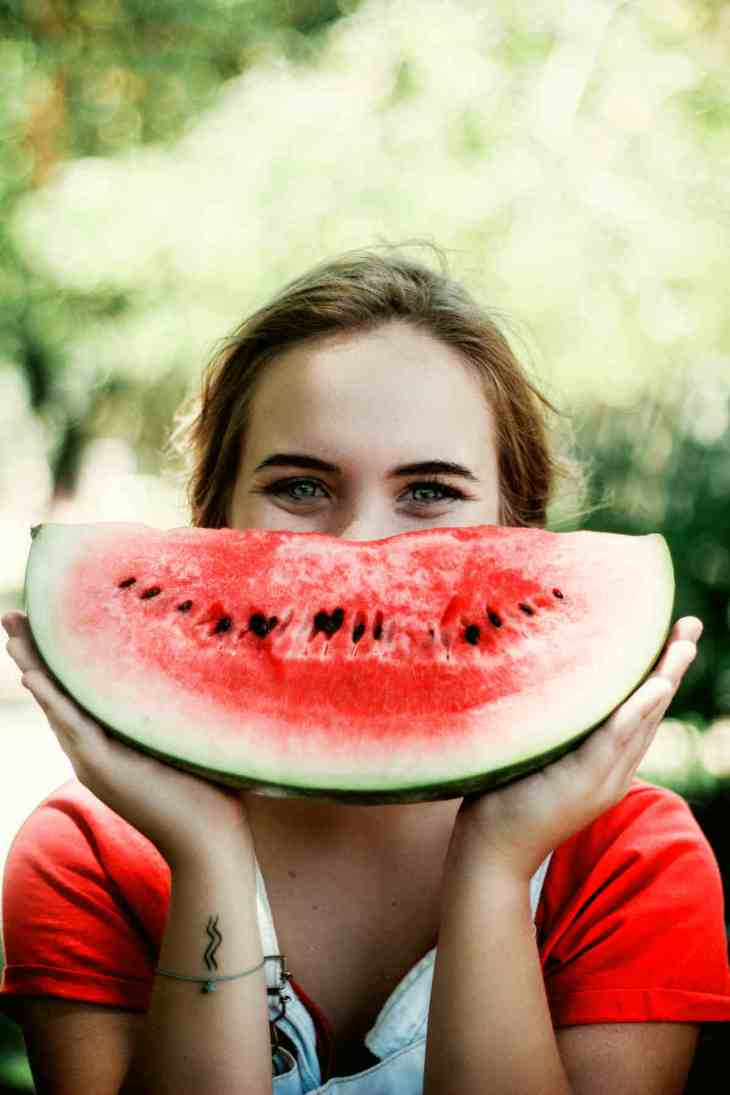 Woman holding sliced watermelon | Fruits and Veggies That Can Keep You Hydrated
