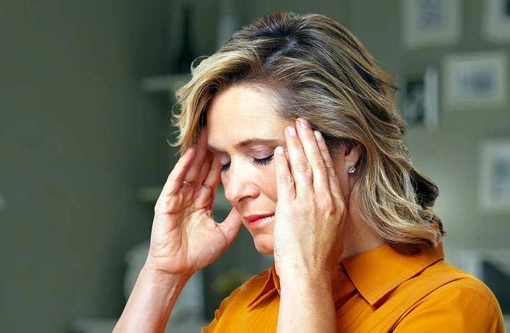 woman having headache | Health Risks of Heavy Metals in Water