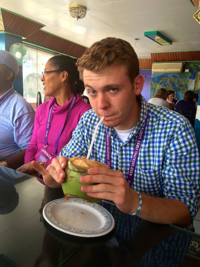 Tyler Cramer drinking from a coconut in Nadi, Fiji