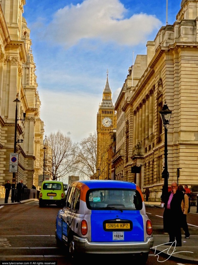 Colorful taxi driving through London, England with Big Ben in the Background.