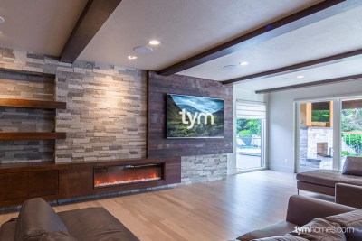 "The completed Family Room with 90"" Sharp TV on a recessed Sanus full-motion TV mount, with TruAudio Surround Sound in-ceiling speakers, Boise, Idaho"
