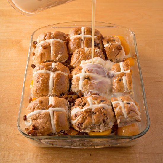 Holly-Cooks-Apricot-and-hot-cross-bun-bread-and-butter-pudding-pouring-on-custard550