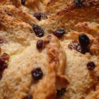 British hot cross bun bread and butter pudding