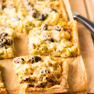 Leek, pesto and olive tart