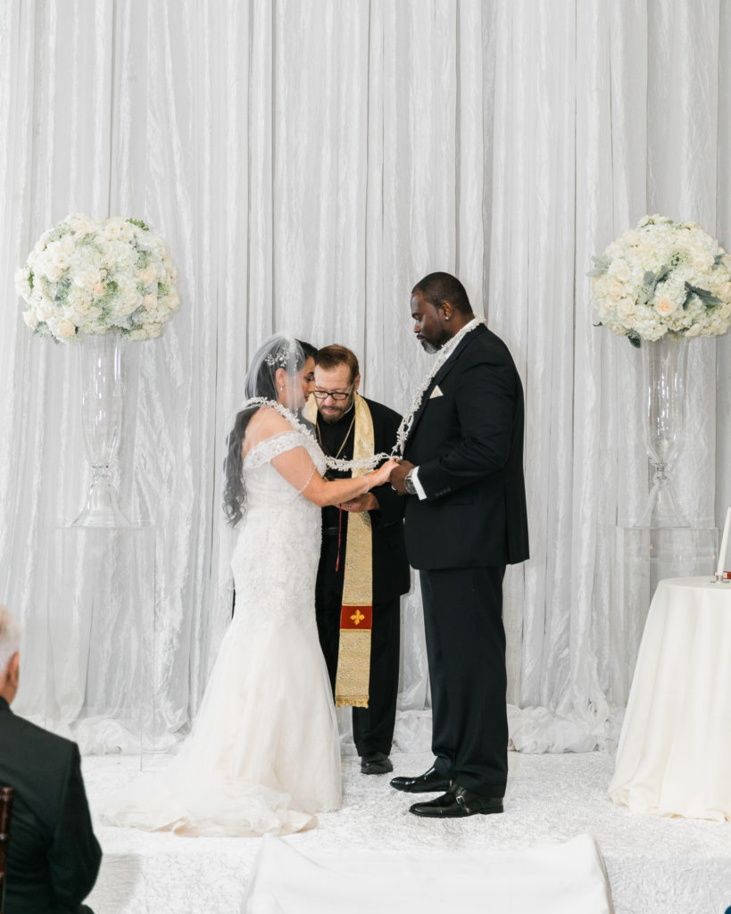 bride and groom exchange vows at their wedding at The Westin San Jose