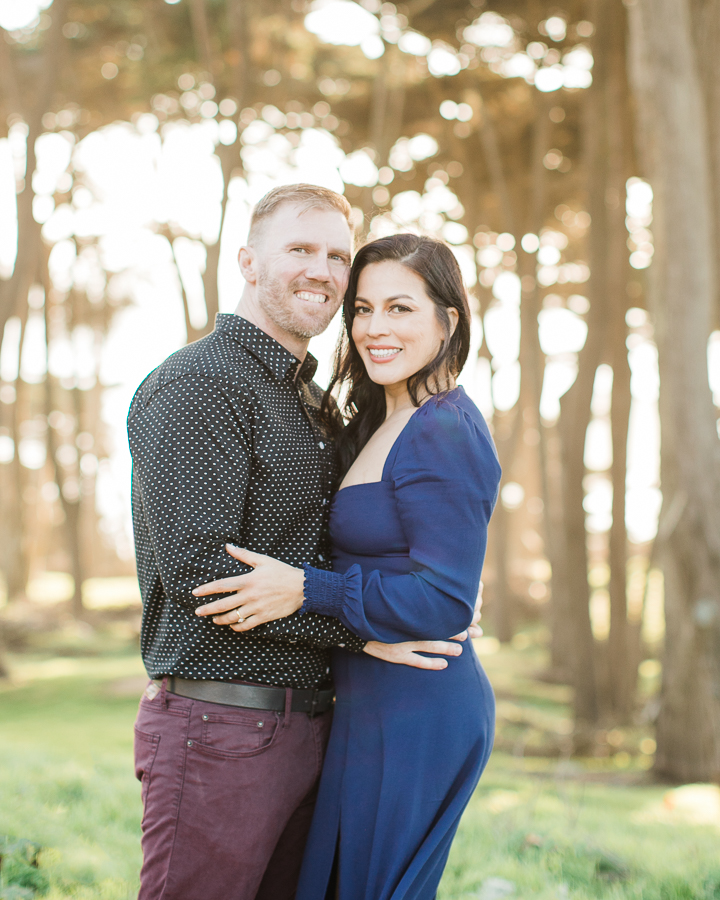 a couple smiles for the camera during engagement photos