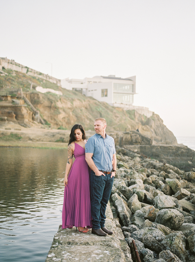 a couple enjoys the scenery during engagement photos at Sutro Baths